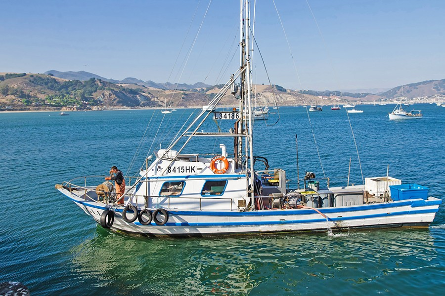 FISH OUT OF WATER Commercial fishing boats like this one are still allowed out on the water, but SLO County's public ramps in Morro Bay and Port San Luis are officially closed to recreational fishers and boaters. - FILE PHOTO BY JAYSON MELLOM