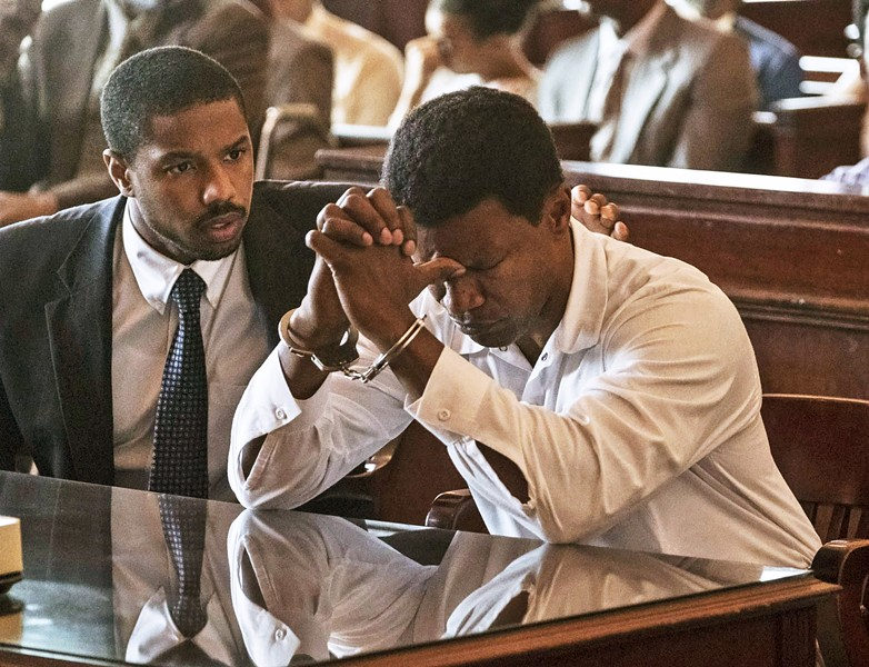 """SETTING THE RECORD STRAIGHT Attorney Bryan Stevenson (Michael B. Jordan, left) faces off against a corrupt criminal justice system in his bid to have wrongly convicted murderer Walter """"Johnny D"""" McMillian (Jamie Foxx) released from Alabama's death row, in the true story Just Mercy. - PHOTO COURTESY OF WARNER BROS. PICTURES"""