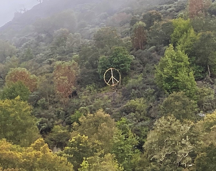SHINING BRIGHT As they go over the Cuesta Grade, drivers on Highway 101 can see Lyle Nighswonger's peace sign made from an old satellite dish. - PHOTO COURTESY OF MARBY HAMBRIGHT