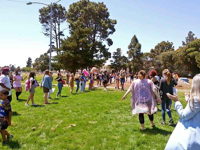 CELEBRATING PRIDE About 100 people gathered at Ryon Park in Lompoc to celebrate Pride Month and remember LGBTQ-plus community members who have been killed violently. - PHOTO BY ZAC EZZONE