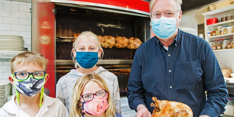 Tasty To-Go SLO Provisions owner Steve Bland and his grandkids show off rotisserie chicken—a lemon and herb-brined Mary's free range chicken slow cooked in the French rotisserie—one of many delicious items on the Best Takeout Menu around.