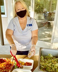 CHIPPING IN El Camino Homeless Organization (ECHO) volunteer Wendy Johnson serves dinner to clients in Atascadero on Jan. 7. ECHO is looking for more community volunteers to help with its expansion to Paso Robles.