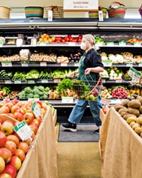 COMMUNITY-OWNED Kit Sanders strolls through the produce section at the Best Natural Food Store around, the SLO Food Co-op, where you can find organic local produce; grab 'n' go meals; herbs; bulk grains, nuts, and treats; organic natural meats; and more.