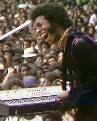 'TAKE YOU HIGHER' Sly Stone entertains a huge crowd during the Harlem Cultural Festival, which took place over six weekends in 1969, in the new documentary Summer of Soul, screening at The Palm Theatre and on Hulu.