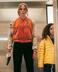 KILLER ELITE Female assassin Sam (Karen Gillan, left) has to retrieve kidnaped Emily (Chloe Coleman), in the female-centric shoot-'em-up Gunpowder Milkshake on Netflix.