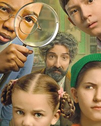 TEAMWORK An eccentric genius (Tony Hale, center) assembles a team of children to go on a dangerous mission to save the world, in The Mysterious Benedict Society.