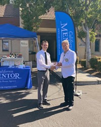 A NEW HOME California MENTOR Family Home Agency's ribbon cutting ceremony with Program Director Wesley Marking (left) and Santa Maria Chamber of Commerce Ambassador Paul Klock (right), marks the grand opening of the Santa Maria Office.