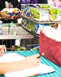 FREE LUNCH:  Kids receive free lunches this summer from the Lovin' Lunchbox program, hosted by the Food Bank Coalition.