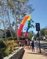 SOMEWHERE OVER ...:  Folks flocked to Sunday's Pride in the Plaza to grab food, LGBTQ-themed souveniers, and to see several great performances on the main stage, including Alex Newell from Glee.