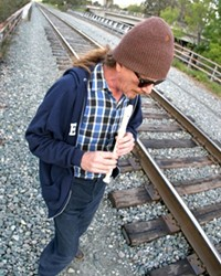 PUBLIC FLUTING :  Eric Cletsoway recently walked the section of tracks where he was arrested for trespassing over Mardi Gras weekend. The flautist was injured by police during the arrest.