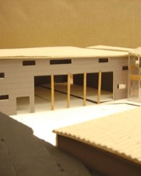 MODELING COMMUNITY :  Cal Poly architecture major Kimiko Kohnos design for a Nipomo community center features a central courtyard, surrounded by a theater, kitchen, and gathering space. In her conceptual description, Kohno included plans for a security system that tracks childrens whereabouts with identification cards.