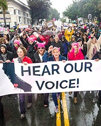 <p>Demonstrating unity: SLO County Women's March participants said it loud and proud