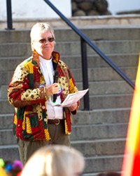 COLLABORATE The Rev. Caroline Hall speaks at the June 7 LGBT rally in Mission Plaza. Hall is one of several local pastors working to create a welcoming community of faith in SLO County.