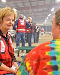 LENDING AN EAR Longtime Red Cross volunteer Carolyn Pandol listens to shelter resident Michelle Mullin tell the story of how she escaped from the Thomas Fire.