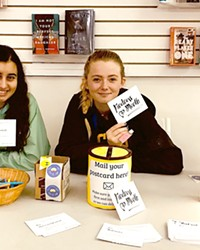 """SPREADING KINDNESS SLO High School REACH Club members Malia Cariño (left) and Sabrina Marks (right) hold up """"kindness cards,"""" which were individually crafted and distributed to 700 peers, staff, and teachers last March."""
