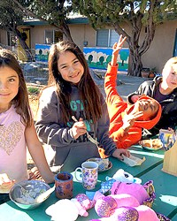 FOOD AND FUN Santa Lucia School students enjoy their lunch and play outside.