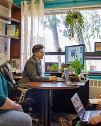 EXPANDING SERVICES Dr. Jay Bettergarcia, a Cal Poly psychology professor (at desk), leads the SLO ACCEPTance Project, a four-year venture that delivers 9-month trainings to local therapists to strengthen their competency with LGBTQ clients.