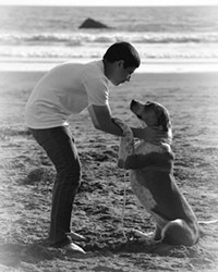 PURE Love, Always captures a tender moment between photographer Trisha Butcher's son and dog.