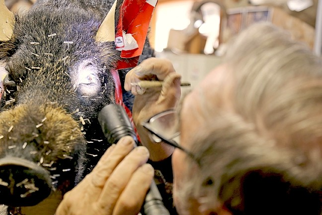 DETAILS:  Don uses a flashlight to make sure the eyes are set just how he wants them. One of the most technical parts of taxidermy is getting the eyes to look realistic by making little adjustments. - PHOTO BY DYLAN HONEA-BAUMANN