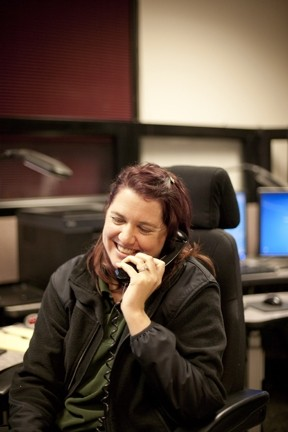 MISDIAL :  Dispatchers are accustomed to accidental cell-phone calls—what they like to call butt-dials—and they sometimes hear chatter on the other end, like when Holly Porter heard someone say, 'Dude, where'd that bong go?' - PHOTO BY STEVE E. MILLER