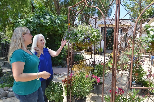 DESTINATION:  Christine Bruno, left, shows a customer around her nursery, Bruno's Greenhouse in Nipomo. - PHOTO BY DAVID MINSKY