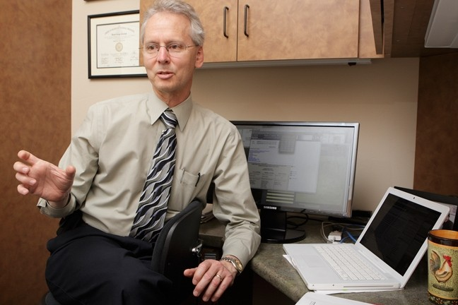 NUMBERS SCHMUMBERS :  South County oncologist Dr. David Palchak doesn't see evidence of a significantly higher cancer rate in SLO County, despite statistics that might indicate otherwise. - PHOTO BY STEVE E. MILLER