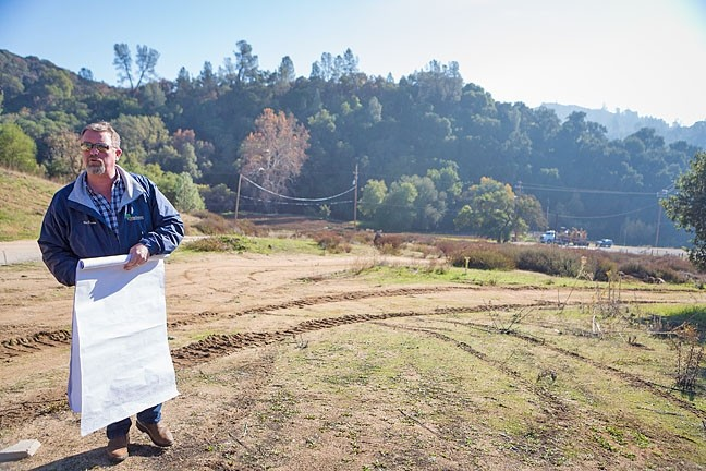 MAPPING DEBATE:  Ken Johnston, project manager for the proposed Las Pilitas quarry, said the operation would supply a needed source of rock. Opponents of the project, many who live in the area surrounding the site, don't buy that. - PHOTO BY KAORI FUNAHASHI