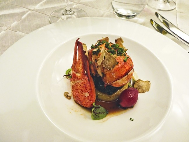 LOBSTER FOR THE WIN:  The chefs' butter poached lobster with Bloomsdale spinach, potato fondant, and sauce perigeux is guaranteed to delight. - PHOTO BY DAN HARDESTY