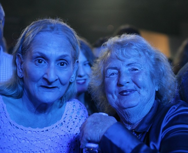 DOWN OFF THE MOUNTAIN:  Linda and Muriel may not have been the youngest people at the show, but they were the most ambitious—they had front row center stage position at the concert. - PHOTO BY GLEN STARKEY