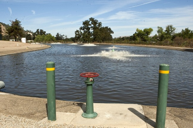 SMELLS LIKE A SOLUTION? :  Every year, roughly 93 million gallons of water are reclaimed from this Wastewater Treatment Plant in Atascadero for irrigation at Chalk Mountain Golf Course. Plant officials said no bacteria have been found in the water, but poor public perception and expensive infrastructure hamper efforts to get more people interested in using it. - PHOTO BY STEVE E. MILLER