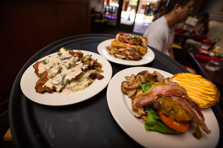 A BURGER OR A BRAT:  Burgers, bratwurst, and schnitzel (breaded and fried tenderized pork loin topped with mushroom Jagr sauce) is served at Wineman - GrillHause at 851 Higuera St. in downtown SLO. - PHOTO BY KAORI FUNAHASHI