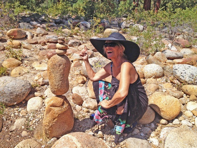 TOWERING FIGURE:  Kathy Clarke (right) has been stacking rocks most of her life, as a hobby and as a way to enhance the outdoor experience. - PHOTO COURTESY OF KATHY CLARKE