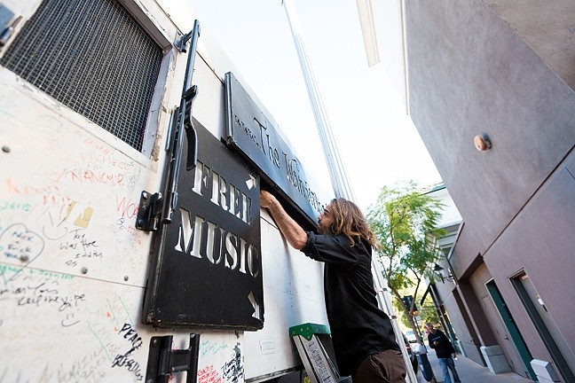 NICE SET:  Jeffrey's customized box truck, nicknamed Betsy, only takes about 10 minutes to get ready. For big shows, he's installed a large projection screen to broadcast tunes and video to the bustling crowds. - PHOTO BY KAORI FUNAHASHI