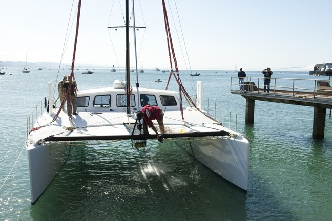 CHRISTENED! :  With one swift swing of a champagne bottle, Nick Del Giorgio's boat, Tunnel Vision, is officially seaworthy. - PHOTOS BY STEVE E. MILLER