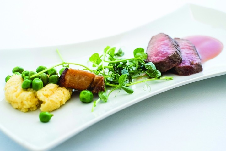 DELICIOUS :  Apple Farm Chef Steven Smeets creates lamb loin with polenta, pork belly, peas, and tomato gastrique.