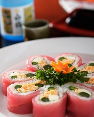 HEAVENLY :  The new fall menu at Sushiya offers a fabulous juxtaposition of textures and flavors, such as the cherry blossom roll, which contains crab, asparagus, and cilantro, wrapped with tuna. - PHOTO BY STEVE E. MILLER