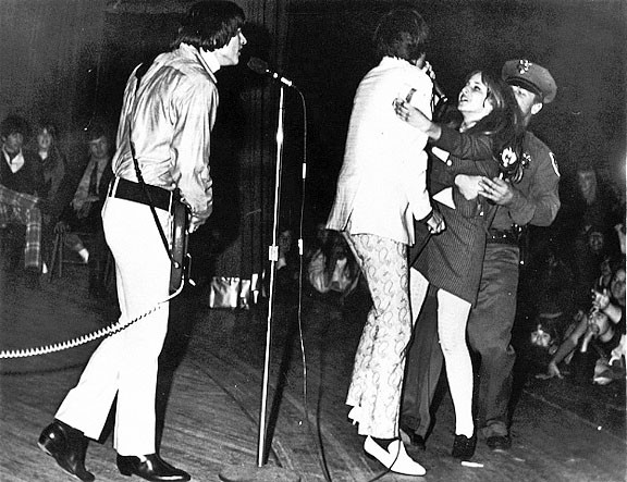 HYSTERIA!:  A girl rushes the stage and grabs The Seeds frontman Sky Saxon at one of their shows. - IMAGE COURTESY OF GNP CRESCENDO RECORDS