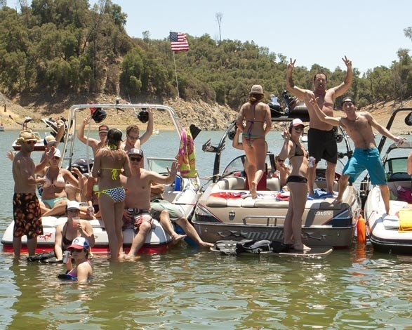 REVELRY ON THE WATER :  Most of the boaters and their friends were happy to show how much fun they were having, as the deputies and the New Times reporters were on the job and thus unable to partake in the festivities. - PHOTO BY STEVE E. MILLER