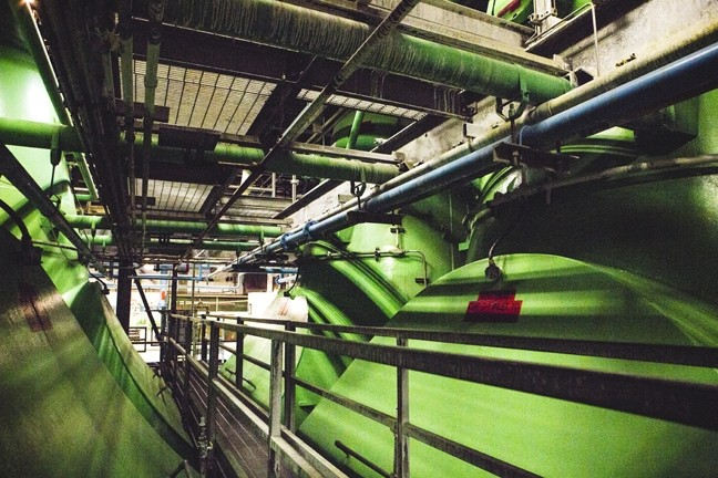 DOWN BELOW:  On a tour of Diablo Canyon, New Times was taken below one of the two massive steam turbines to see the guts of the only active nuclear power plant in California. - PHOTO BY HENRY BRUINGTON