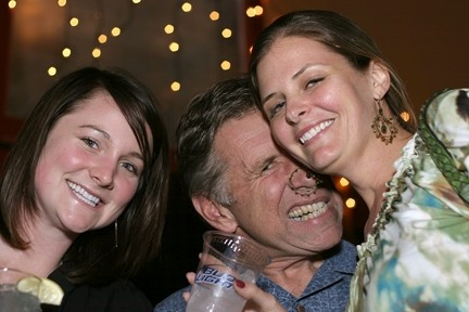 NEVER TOO OLD TO PARTY! :  Emily Sullivan, Steve Myrick, and Jen Anthony get into the spirit. Woo hoo! - PHOTO BY GLEN STARKEY