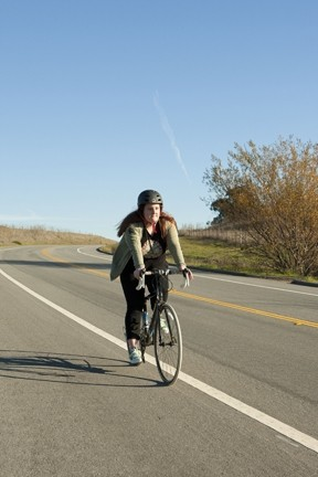 CYCLING THROUGH :  Calendar editor Maeva Considine bikes away the calories with the help of the Cyclemeter app for iPhones. - PHOTO BY STEVE E. MILLER