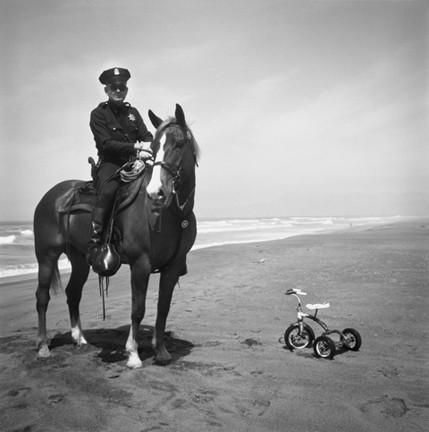 TRICYCLE POLICE :  By 1964, visual non-sequiturs such as this one were already a hallmark of the photographer's style. - PHOTO BY ARTHUR TRESS