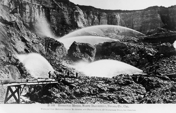 SCORCHED EARTH:  Later large-scale mining efforts included such destructive methods as this hydraulic mining operation in North Bloomfield, Nevada County, Calif., circa 1870. - ALBUMEN PRINT BY CARLETON E. WATKINS; COLLECTION OF THE CALIFORNIA STATE LIBRARY