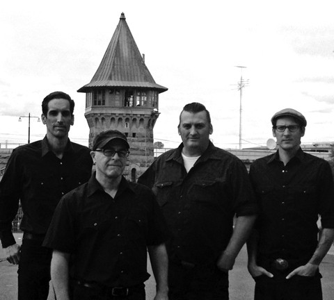 FOLSOM PRISON BLUES:  Johnny Cash tribute act Cash'd Out, shown here in front of Folsom Prison, returns to SLO Brew on March 21. - PHOTO COURTESY OF CASH'D OUT