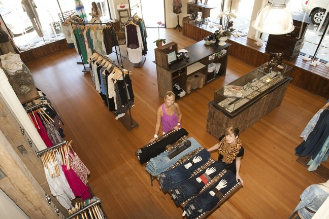 LOOKING GOOD:  Ambiance, the women's clothing and accessory store, has expanded to a second location in downtown Paso Robles. Manager Camilla Burns (left) and Naomi Hanson will be there to help you look your best. - PHOTO BY STEVE E. MILLER