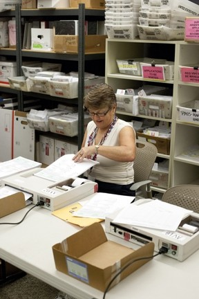 MAKING 'EM COUNT:  County clerk-recorder Julie Rodewald was extra busy counting mail-in ballots and the returns from polling stations on election night. - PHOTO BY STEVE E. MILLER