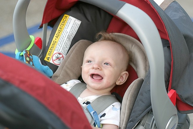 HIS FIRST ART SHOW! :  Six-month-old Bode Maire is all smiles at his first art show. - PHOTO BY GLEN STARKEY
