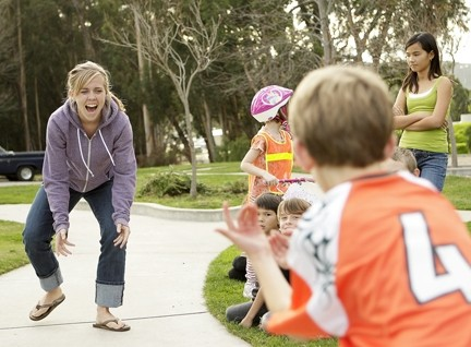 VOLUNTEER :  Emily Buckel playS two square with kids in the after- school program. - PHOTO BY STEVE E. MILLER