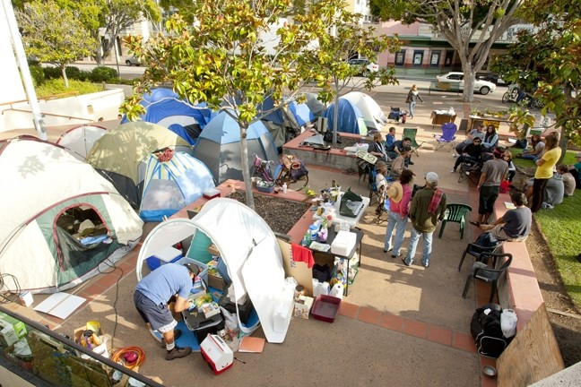SHANTY OCCUPATION :  After a week of protest, the Occupy SLO movement turned into a transient camp; the steering committee withdrew its support to plan for a more cohesive effort. - PHOTO BY STEVE E. MILLER