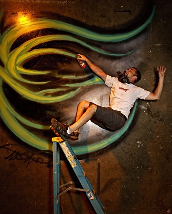 LIVING ON THE EDGE :  In a photo shoot for New Times' Autumn Arts Annual, graffiti artist Derek Brown feigned a terrible accident. The shoot was part of a series that recruited willing artists to toy with perspective: He's actually lying on the ground. - PHOTO BY STEVE E. MILLER
